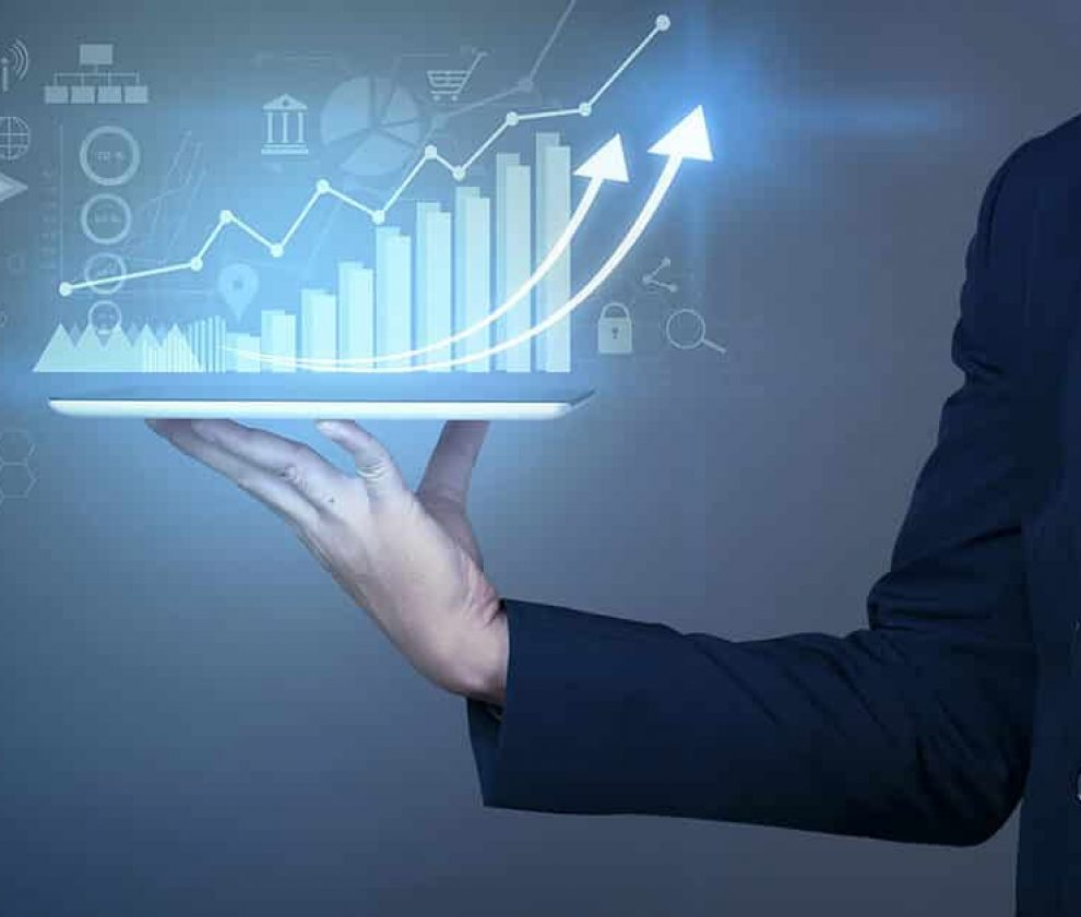 Businessman is holding financial growth graph and analyzing business data, business plan and strategy concept .