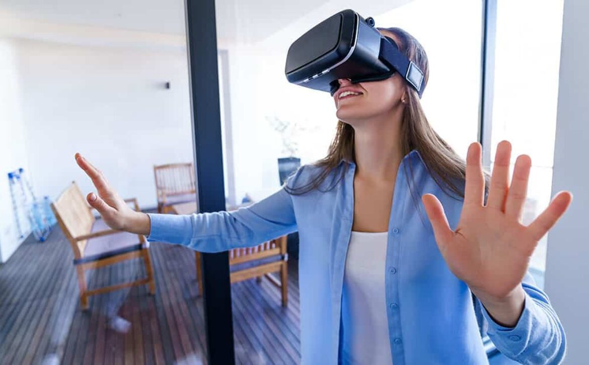 Amazed surprised young woman with virtual reality glasses touchi